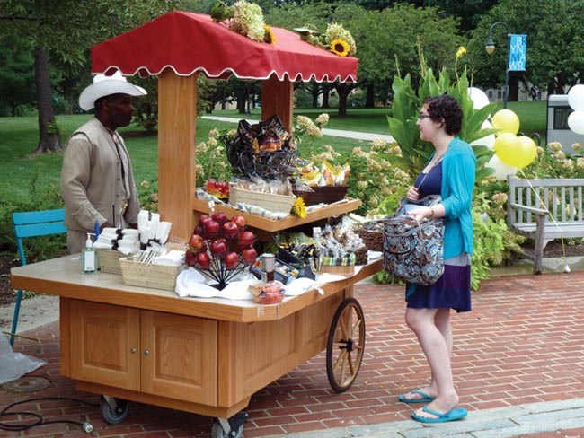 photo of food cart with BMC Dining Services staffer and student
