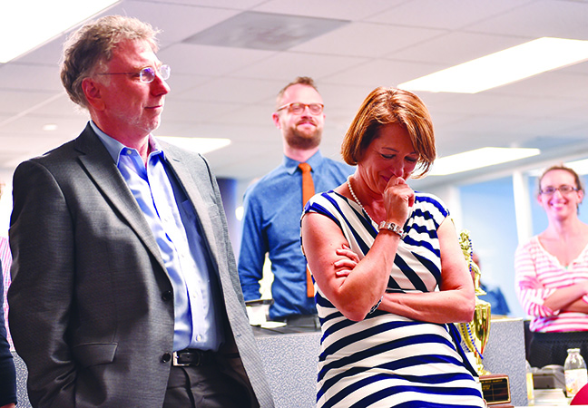 WASHINGTON, DC - APRIL 20: Washington Post Executive Editor Marty Baron, left, listens and looks on as reporter Carol D. Leonnig, right, has a moment while her editor Peter Wallsten, not pictured, speaks about Carol D. Leonnig's Pulitzer Prize award for National Reporting during a gathering at The Washington Post on April 20, 2015 in Washington, D.C. (Photo by Ricky Carioti/The Washington Post)