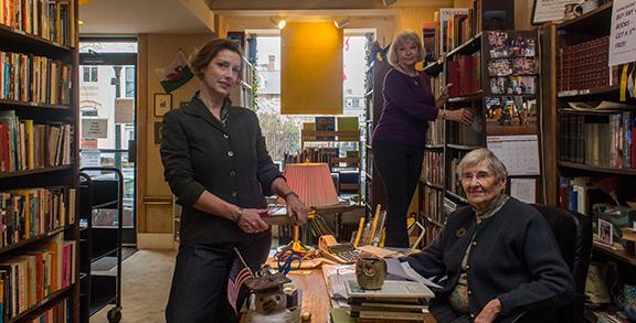 "From left: Susan Flinn '86 (D.C. Club co-president), Caroline Willis '66 (bookstore volunteer), and Elizabeth ""Libbo"" Williams '47 (bookstore manager). Photographs by Murrell Creative Group LLC."